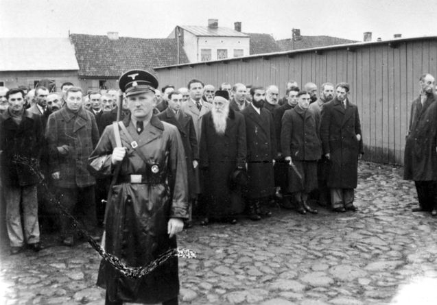 Plousk, Poland, A Gestapo soldier and a group of Jews ...