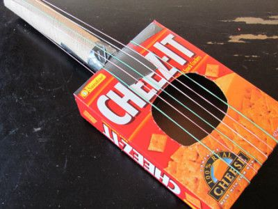 Recycled box guitar cardboard tubes guitars and box make a guitar or bango violin etc out of recycled cracker ccuart Image collections