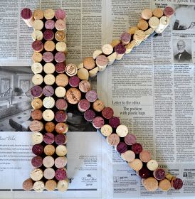 DIY:  How To Make a Cork Monogram - project shows how corks were glued onto a craft store letter.