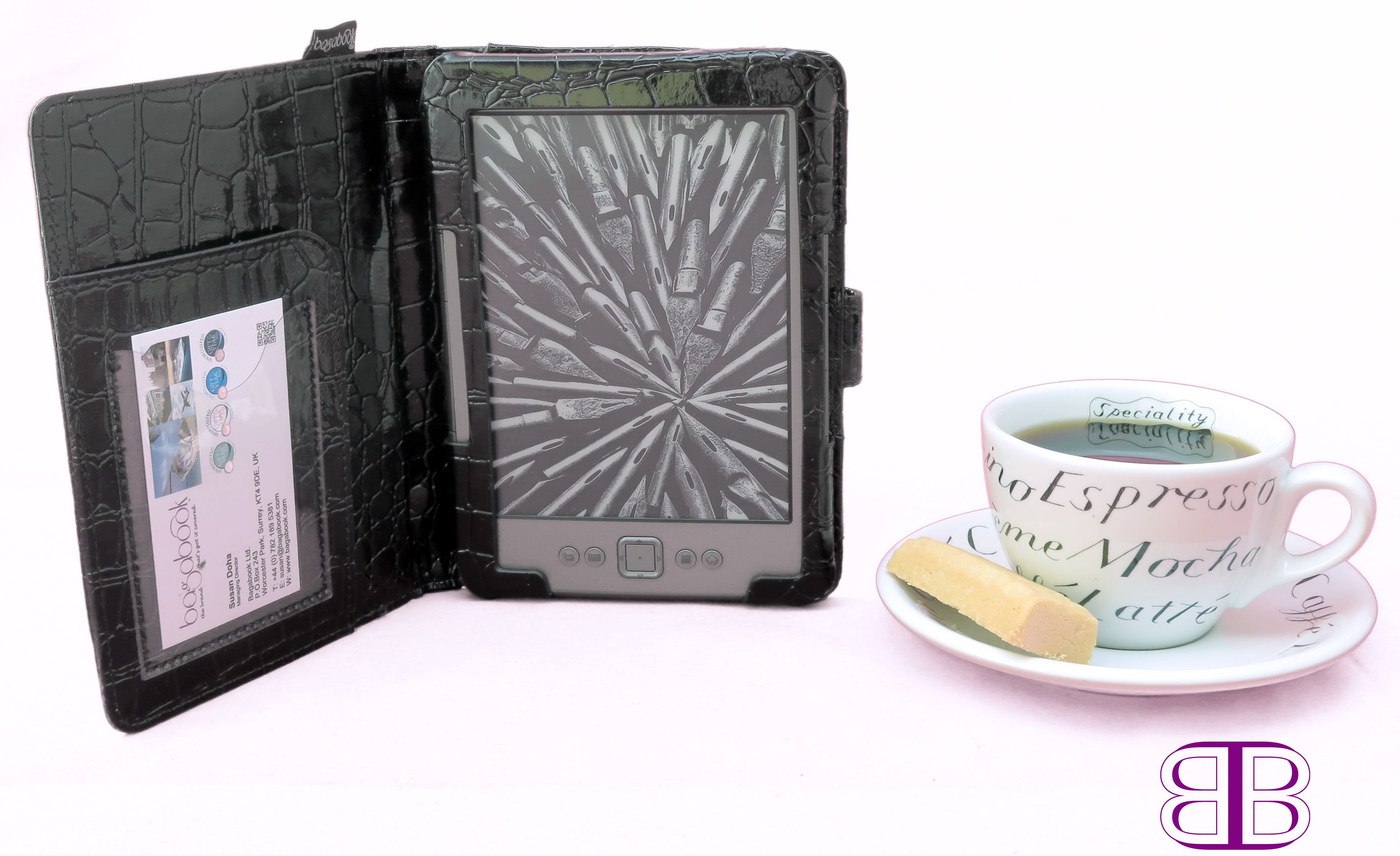 "BB Kindle cover Black. Elegant mock croc, crocodile skin in all its sumptuous shiny detail. Fits 6"" Kindle and e-book. Hand strap and magnetic clasp. Travelcard and ticket slot. Concealed zipped pocket ideal to house the cable."
