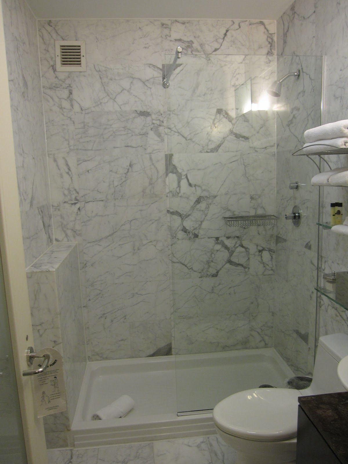 Bathroom shower stalls in small bathroom designs with white marble