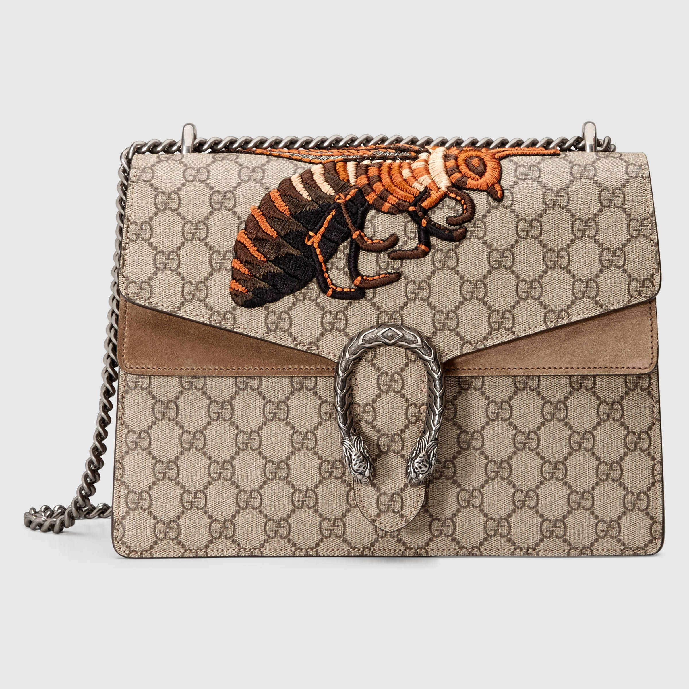 bfab82b40 Shop the Dionysus medium GG shoulder bag by Gucci. An embroidered GG  Supreme canvas bag with our textured tiger head closure-a unique detail  referencing the ...