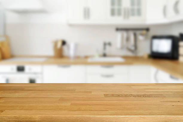 wooden table with blurred kitchen background
