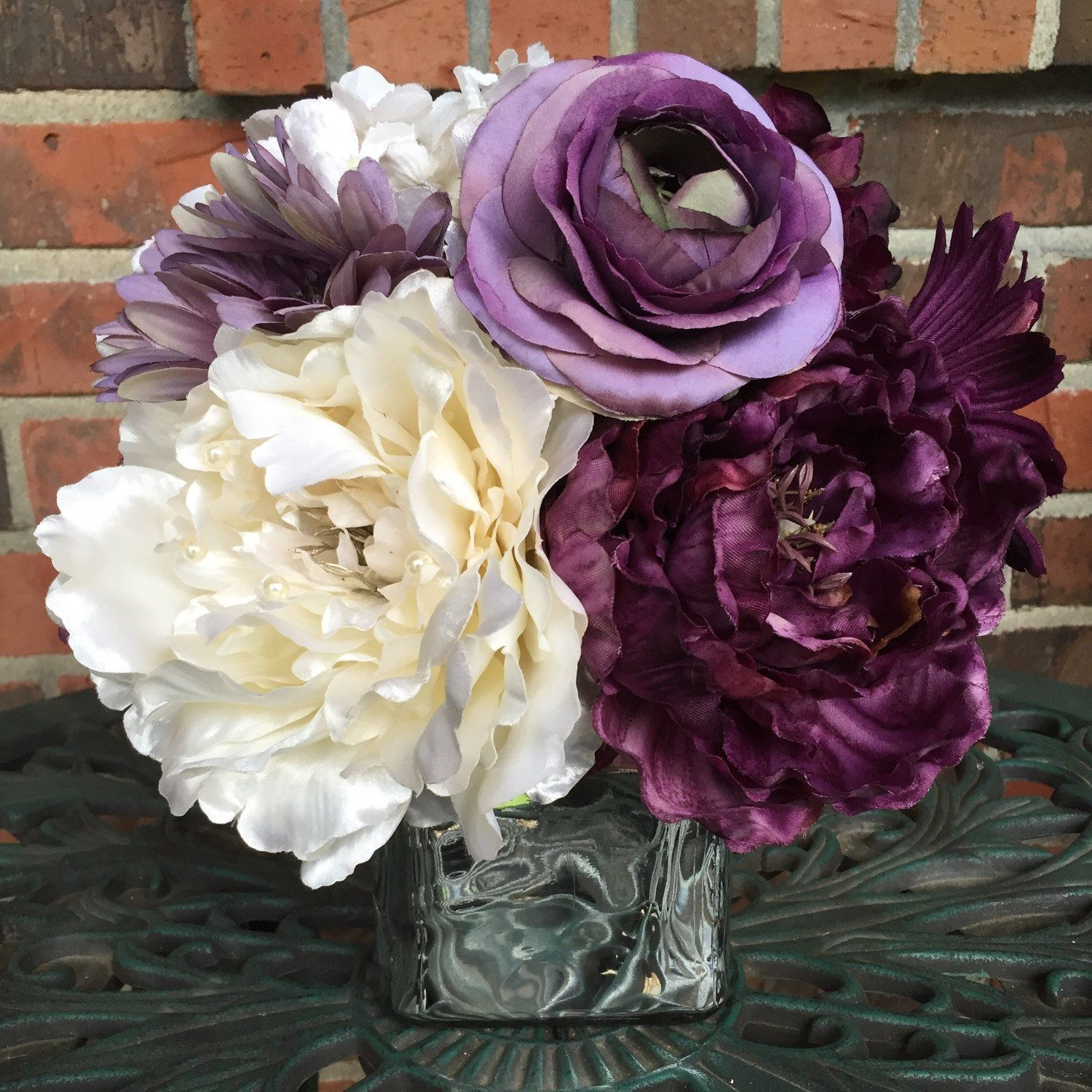 Purple centerpiece and ivory silver