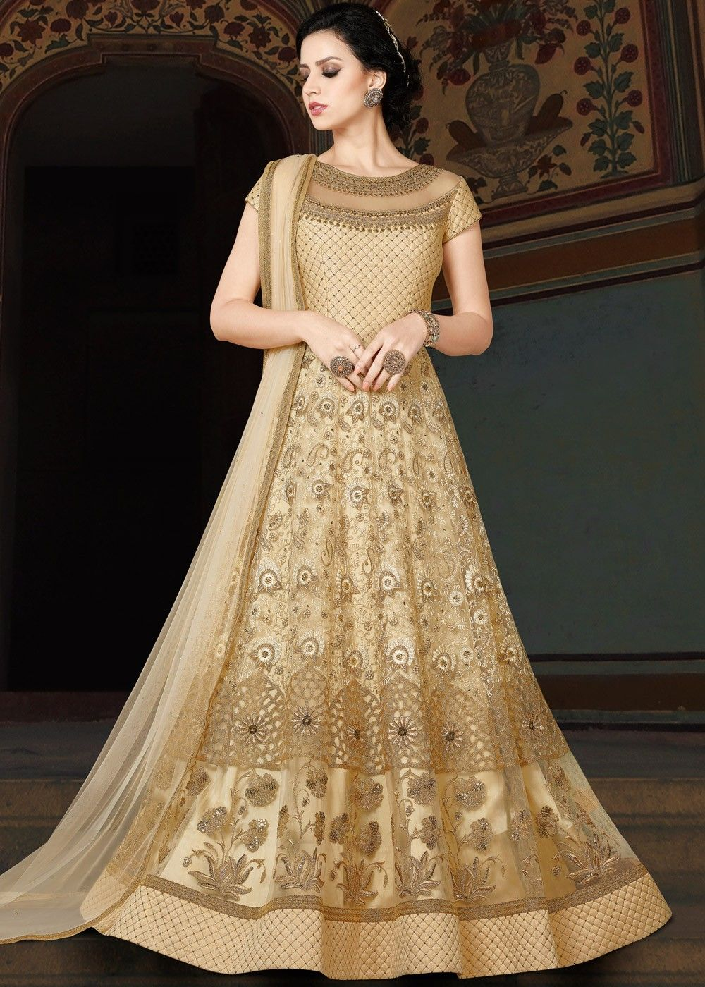 93e2206729c0 Light #gold #short sleeved #net #anarkali with all over #zari, #resham # embroidery and stone work.