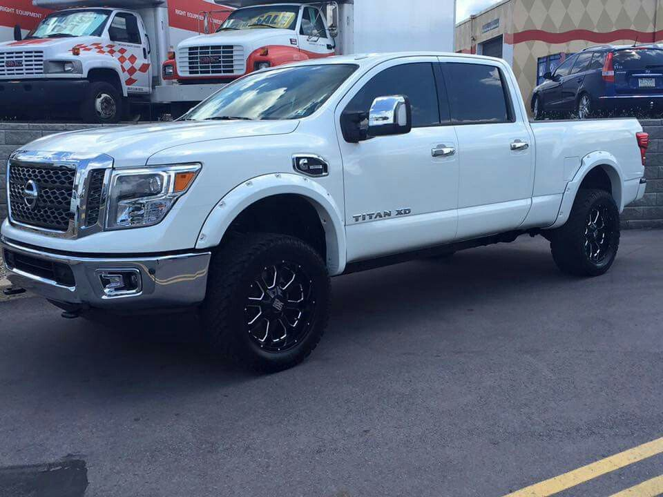 2016 nissan titan xd with a minor rcx lift kmc rims and larger tires new pickup trucks. Black Bedroom Furniture Sets. Home Design Ideas