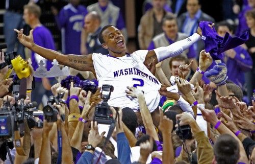 Isaiah Thomas and Husky Basketball celebrating their PAC10 championship at home in 2009