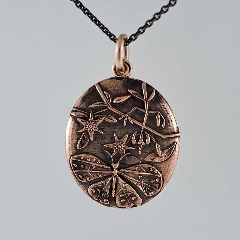 """Something we liked from Instagram! Era's butterfly and deadly nightshade pendant in Rose gold from our """"Floris Fatalis"""" collection. I have a longstanding British murder mystery obsession that has obviously bled into my designs now and again. Do you have any shows or books when the weather turns? #CADdesign #CADjewelry #3dprinter #3dprintedjewelry #jewelry #jewelerystore #jewelrydesigner #eradesignjewellery #handcrafted #handmade #customdesign #shoplocal #shopsmall #locallove #rosegold…"""