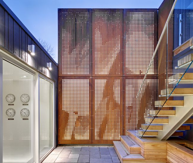 Backlit Perforated Corten Panels Continue The Facade S