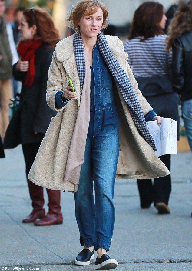 Bundled up: Naomi, 46 donned a furry beige coat over a blue denim jumpsuit and black slip-on sneakers