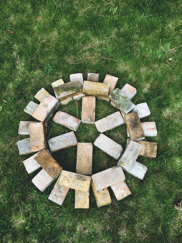 How to Build a Brick Fire Pit in Your Backyard | Backyard ... on Simple Outdoor Brick Fireplace id=92422