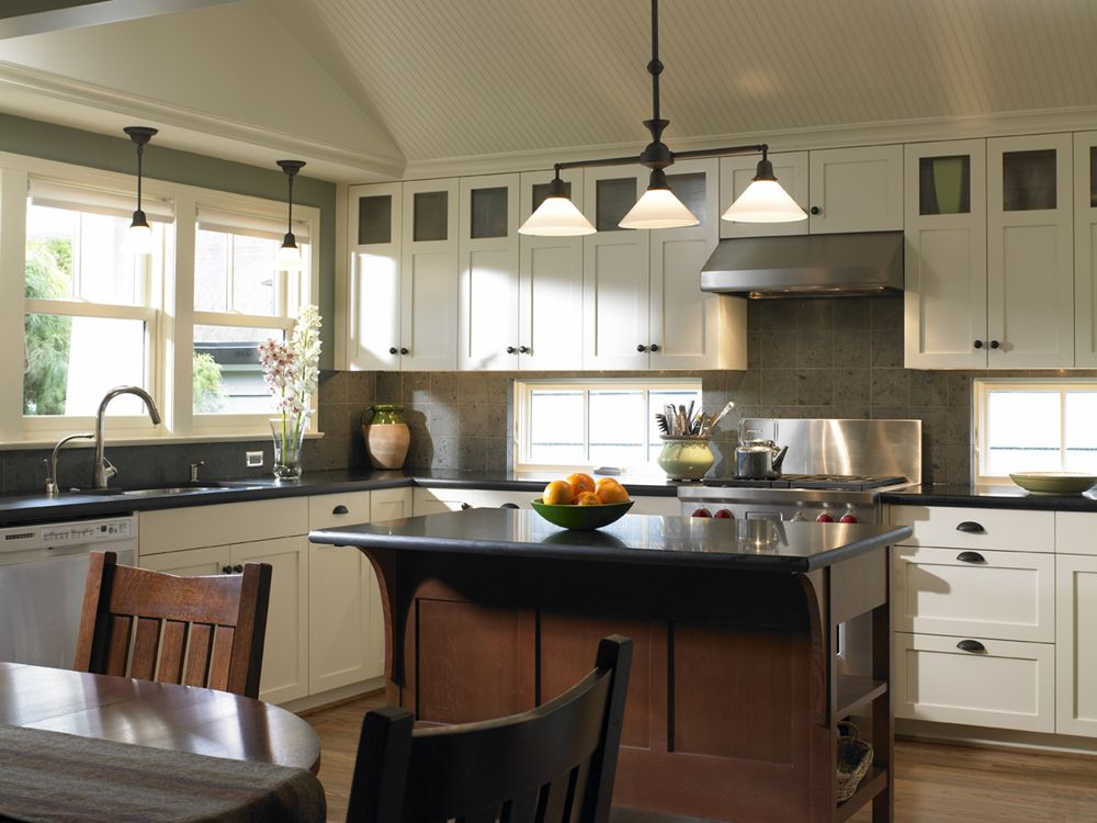 Craftsman kitchen with vaulted beadboard ceiling ...
