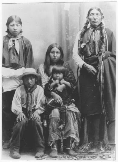 L-R: Bert Seahmer (with unidentified boy sitting in front of him), Utah (holding unidentifed girl), Paaduhhuhyahquetop (the father of Utah) - Comanche - circa 1900