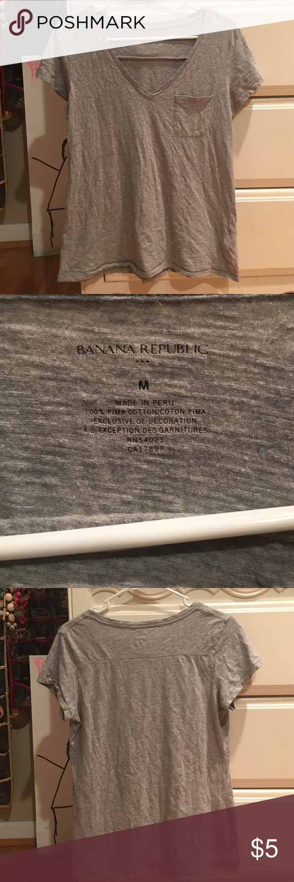 Gray banana republic V-neck tee Gray banana republic V-neck tee -Excellent condition  -Women's M --------------------------------------- -Will Negotiate  -If you have any questions just ask me Banana Republic Tops Tees - Short Sleeve