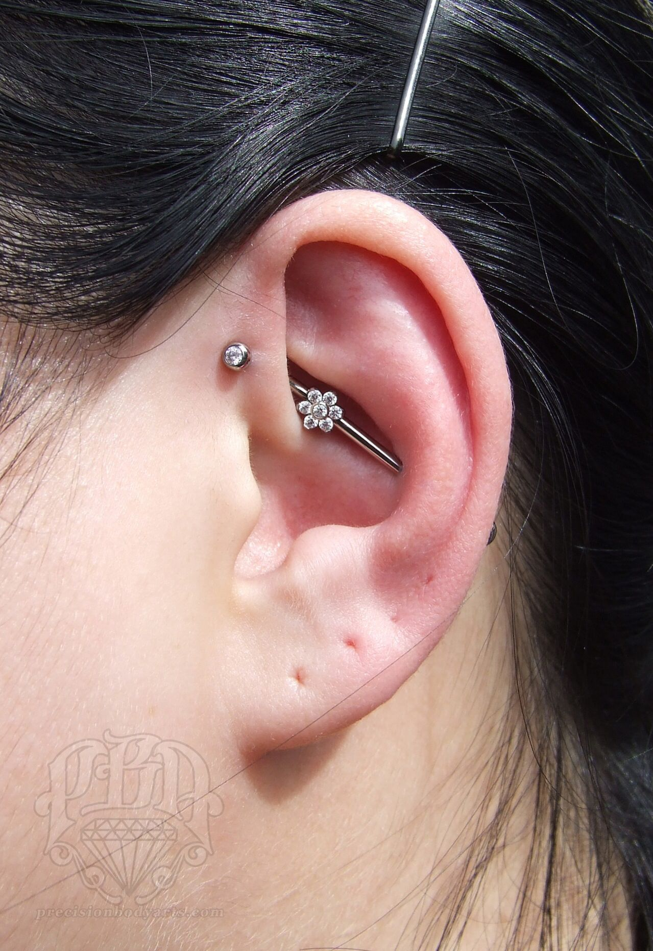 Forward Helix To Upper Conch Industrial Piercing By Ryan