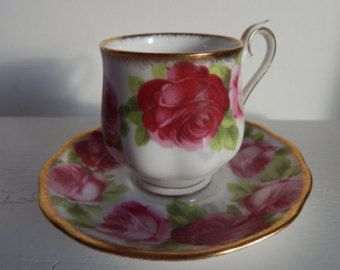 Royal Albert Old English rose cup and saucer very pretty with red roses this is a second but it still looks really good. made in england