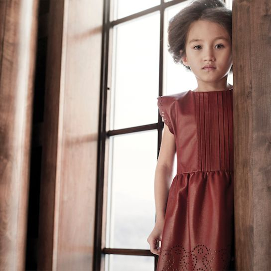 Pale Cloud a/w13 childrenswear features a chestnut leather punched decorative dress