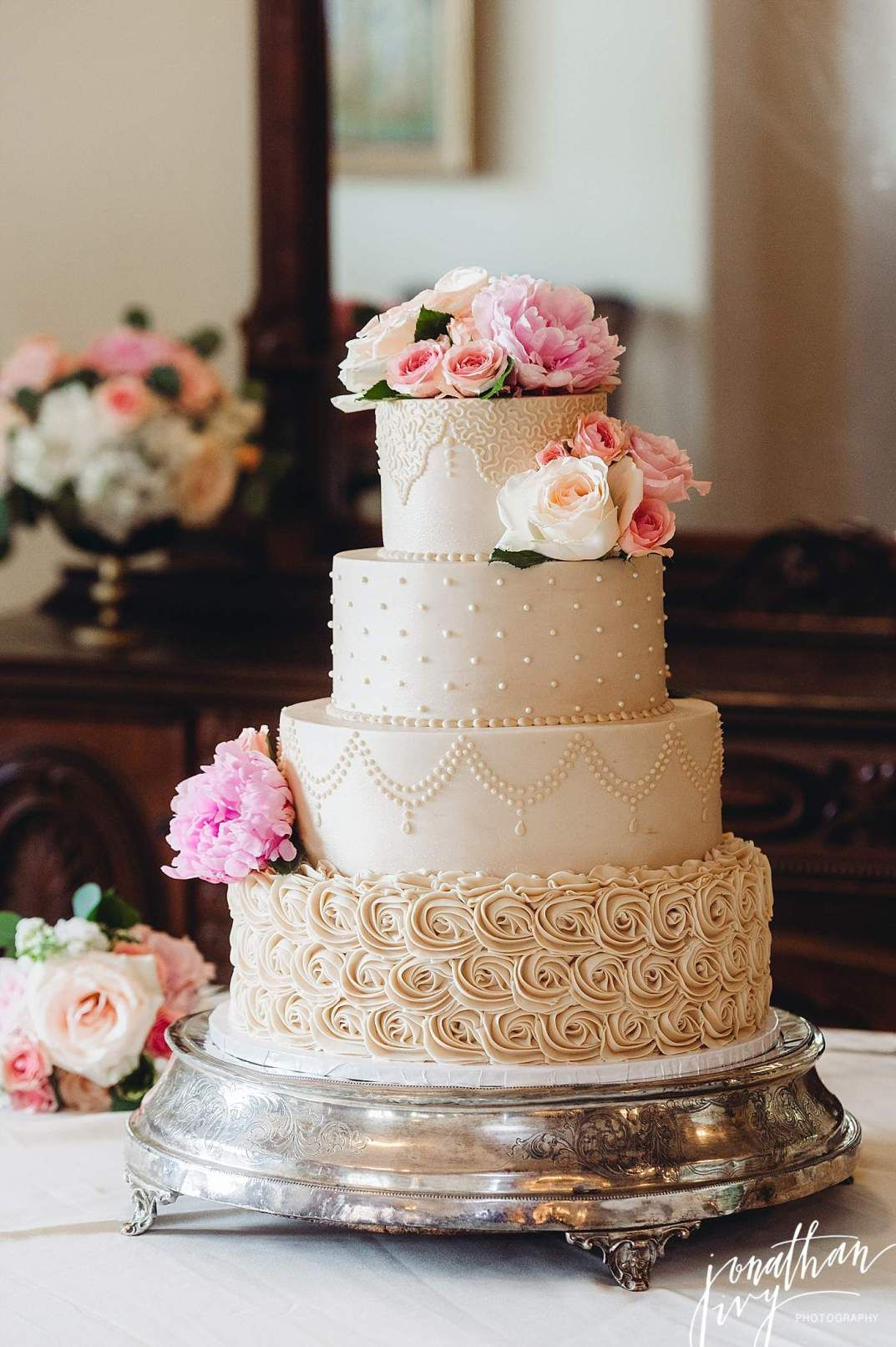four tier wedding cake with flowers beautiful beige 4 tier buttercream wedding cake 14436