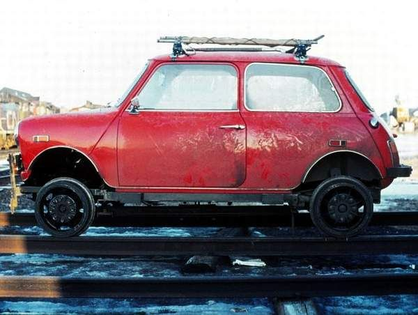 It's not very often that we'll see an Austin Mini used as a railway speeder. The roof rack has some kind of rod on the driver's side   and a long-handled shovel on the passenger's side,  shown in the other photo.  This one was in or around Cochrane, Ontario in April 1976 and belonged to CN.