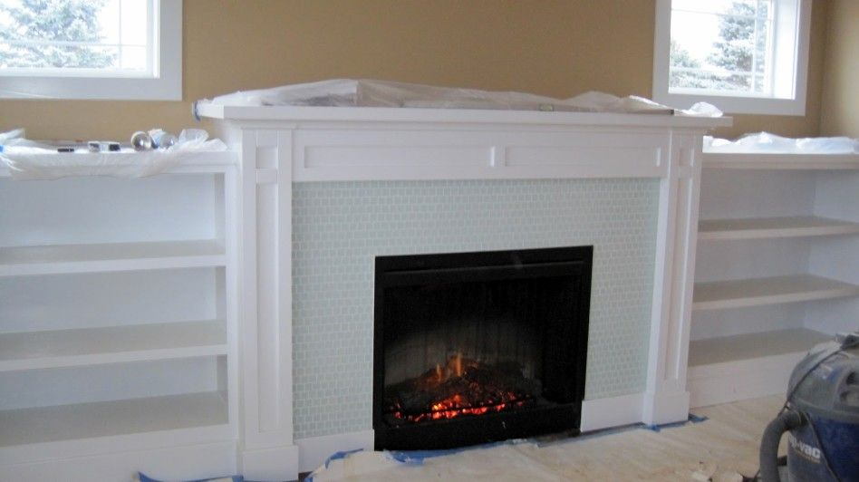 Other design delectable fireplace decoration using small white wood wall bookcase including light blue glass tile surround and also