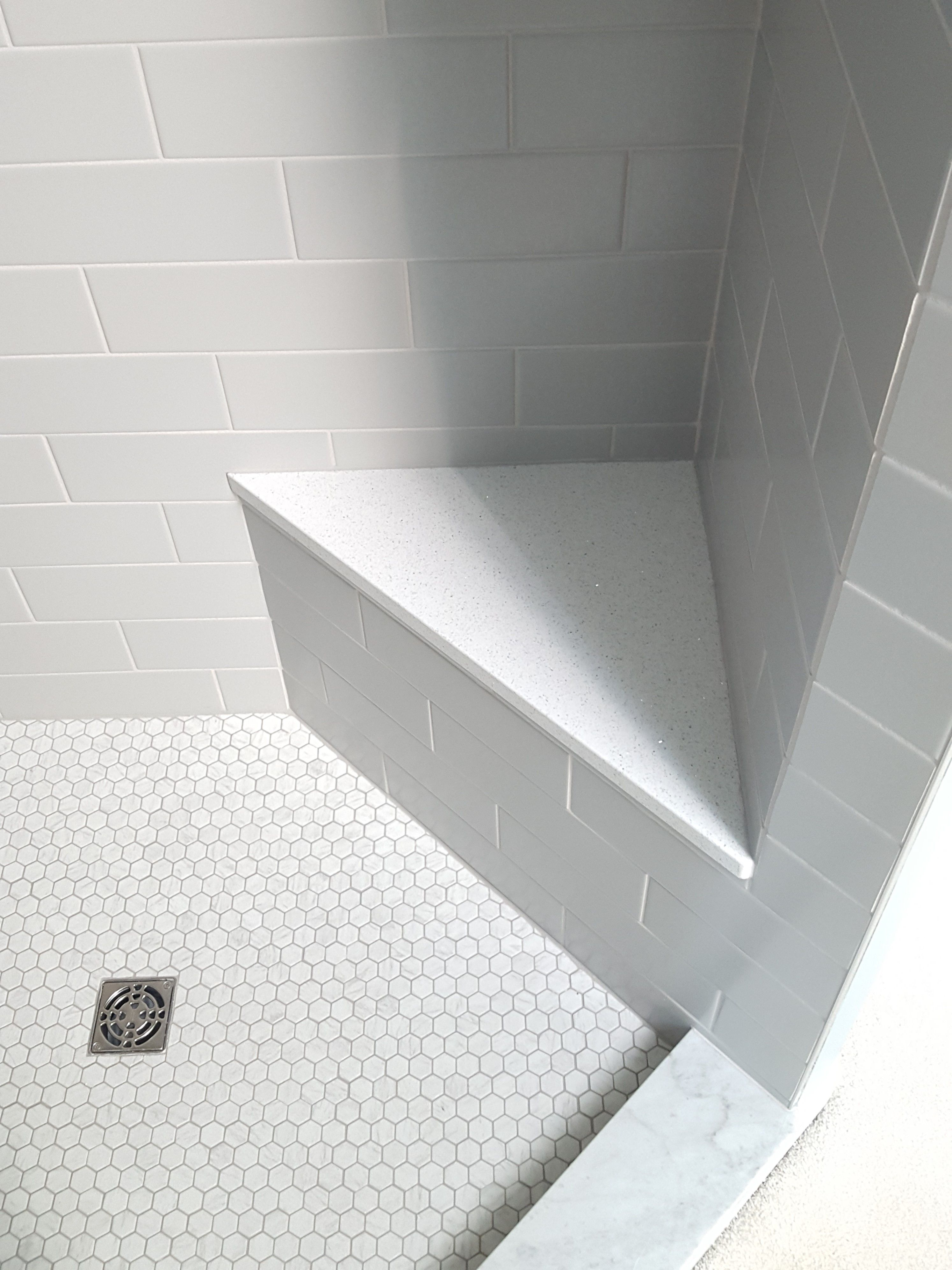 Hanstone Specchio White Quartz Shower Seat Surface Adds A Little Sparkle 4x12 Gray Subway Tiles In Matte Fin Gray Shower Tile Shower Tile White Bathroom Tiles