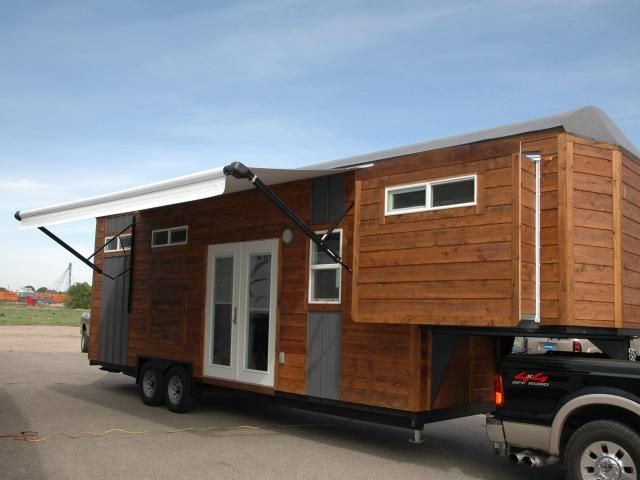 34 RVIA Certified Tiny House With 3 Slides
