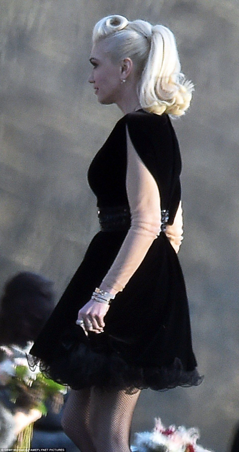 Her own look: The Hollaback Girl donned a black velvet dress with an detailed belt and black sheer frill along the mid-thigh hemline, which showed off her sculpted legs