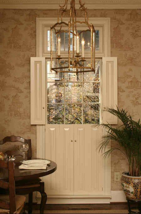 This breakfast nook has raised panel shutters installed on - Raised panel interior window shutters ...