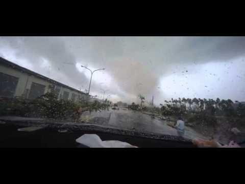 Incredible moment woman SITS through tornado - YouTube