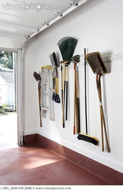 Storage Ideas Garage Iinside Of Door New Construction Vertical View Garden Implements Hanging On Wall Step Ladder Shovels Rakes Broom