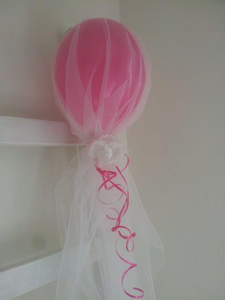 Versier een ballon met thule en lint
