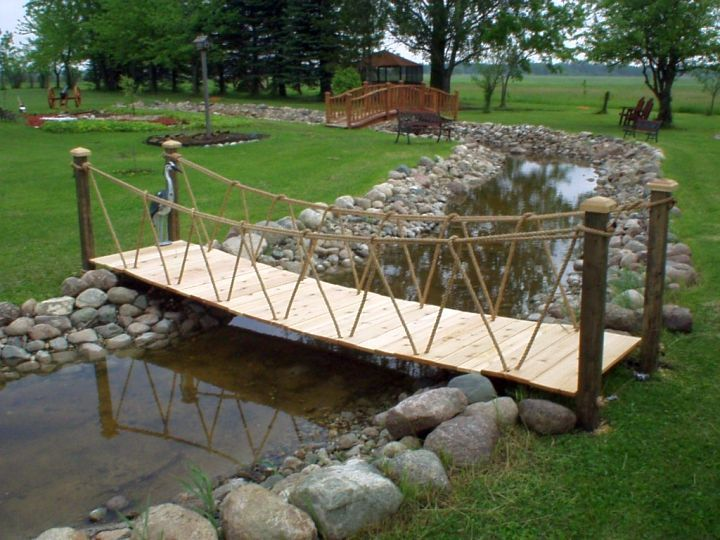 DIY garden bridge with rope railings