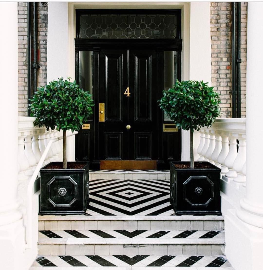 Black White And Chic All Over Worldofinteriordesign Black Double Front Door Black Planters Black And W White Porch House Exterior Double Doors Exterior