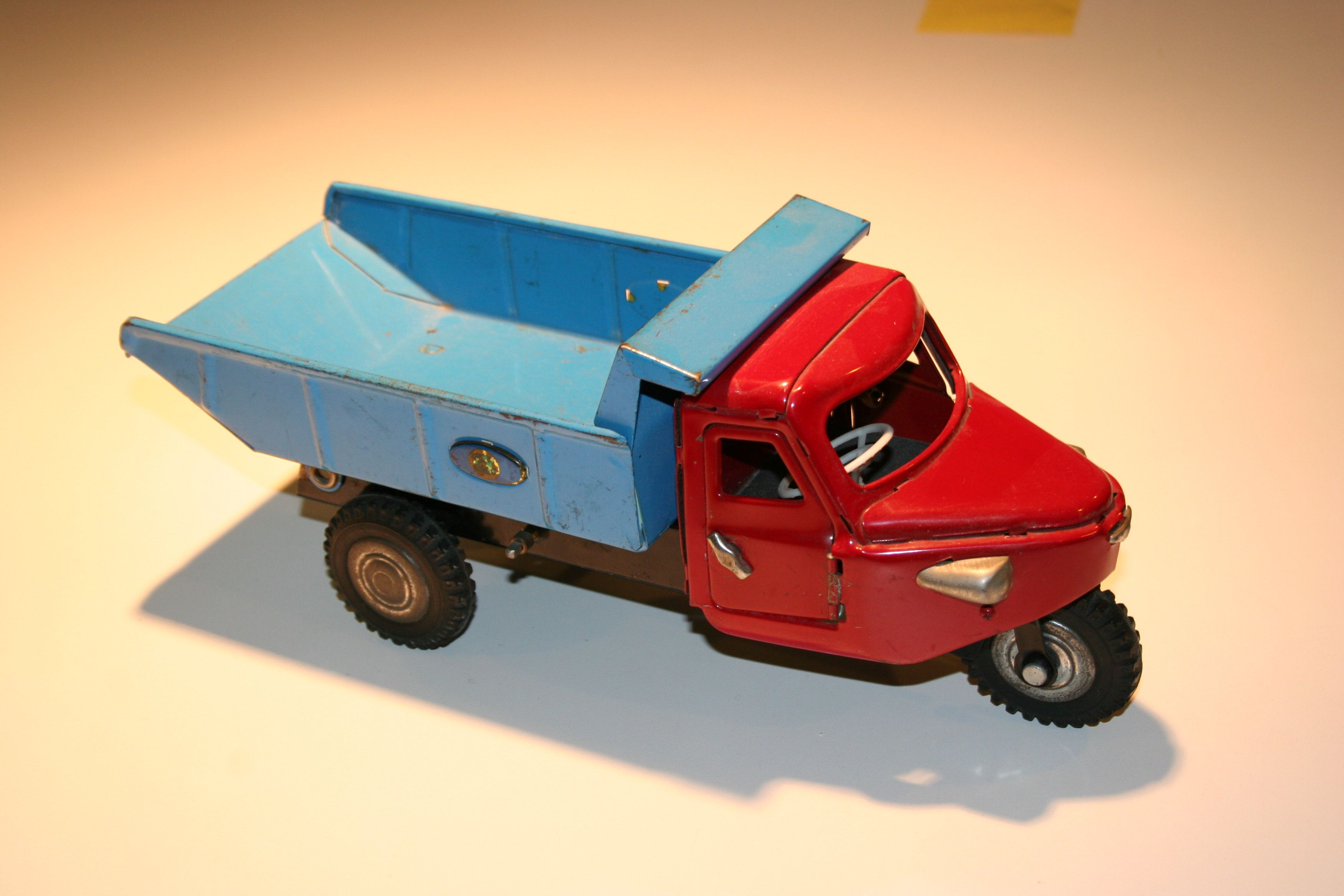 One of my favorite antique toys, a three wheeled truck which has a mechanism to…