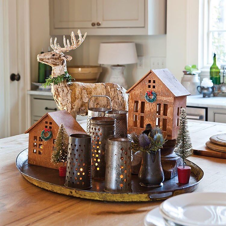 We love it when a treasured collection finds a way to embrace holiday style! How charming is this kitchen vignette? #thecottagejournal