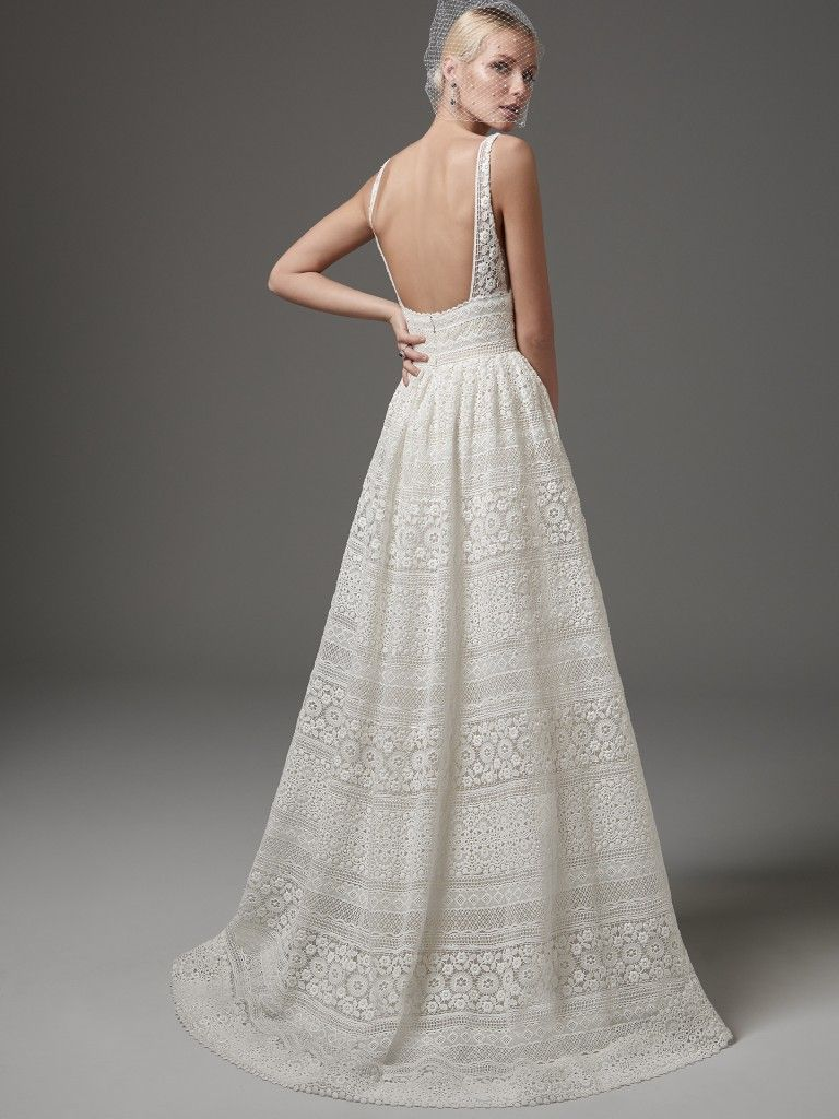 Sottero and Midgley - EVAN, This chic, boho-inspired A-line features sheer pockets and patterns of eyelet lace, floral motifs, and scalloping. Sheer lace straps complete the V-neckline and sexy square-back. Finished with zipper closure. Detachable tulle overskirt with lace waistband sold separately.