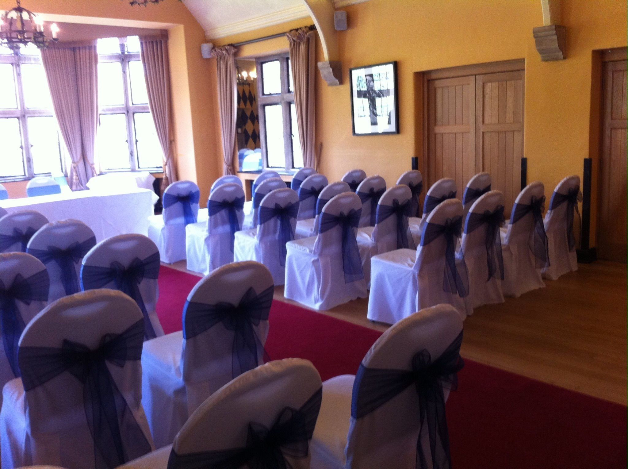 Chair covers with navy sashes