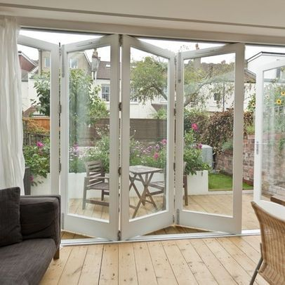 Folding Doors... Love these doors opening out into the garden ...