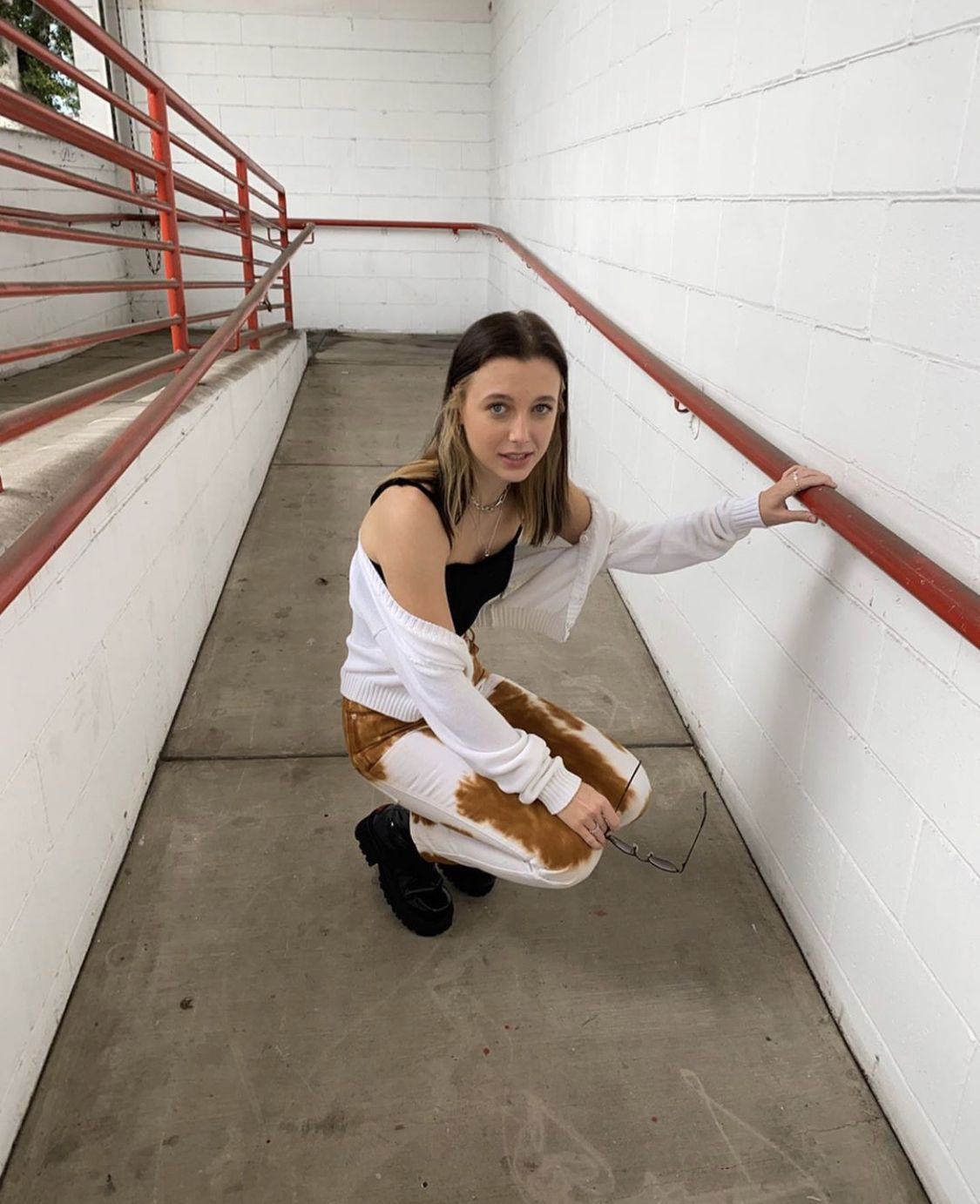 Emma Chamberlain White Cropped Cardigan White Pants With Brown Splatter In 2020 Hair Dyed Underneath Emma Chamberlain Blonde Underneath