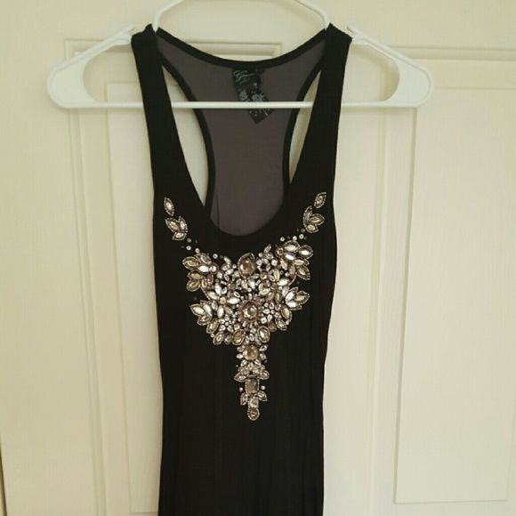 Little black Guess dress Black Guess dress with pretty embellishments on top and grey detail on bottom.  Size XS, fits like a dress size 0. Worn once. Super soft material. Guess Dresses Mini
