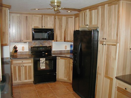 Hickory Cabinets And Black Appliances For The Home Kitchen