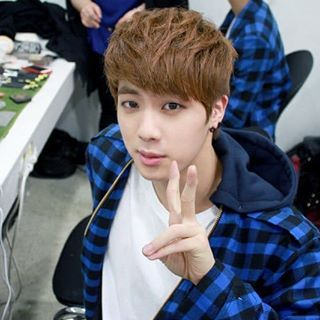 Welcoming Jin's birthday with some of his old photos