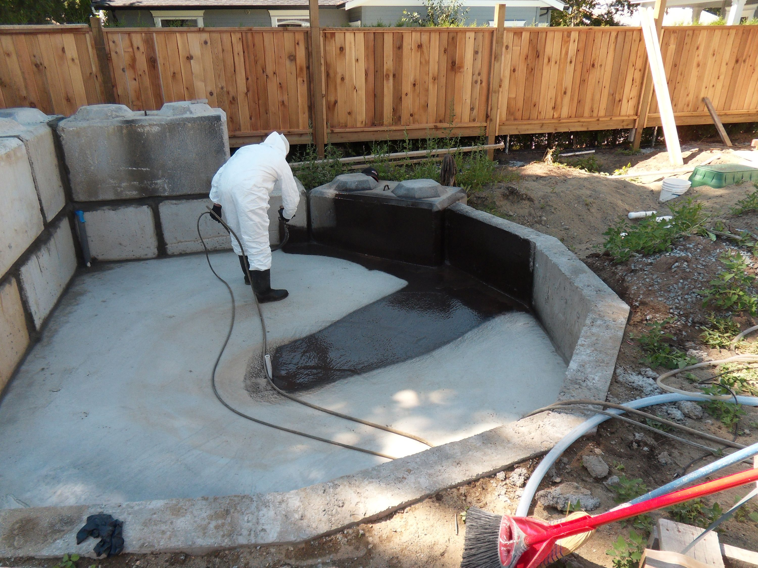 Superpro coating being applied as a pond liner superpro for How to build a fish pond with a liner