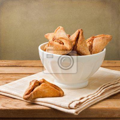 Biscoitos hamantaschen para festa judaica de purim nas imagens da myloview. Da melhor qualidade imagens, adesivos, coleções myloview, fotomurais, posters. Quer decorar a sua casa? Só com myloview!