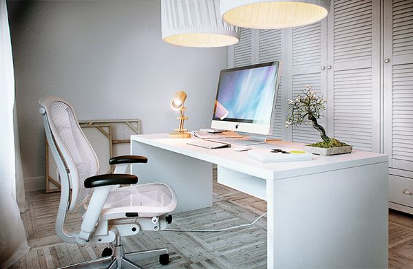 white ergonomic office chairs behind white office desk with
