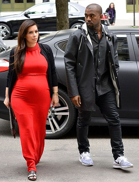 Kim Kardashian Accentuates Pregnancy Curves in Bright Red Maxi With Kanye West in Paris