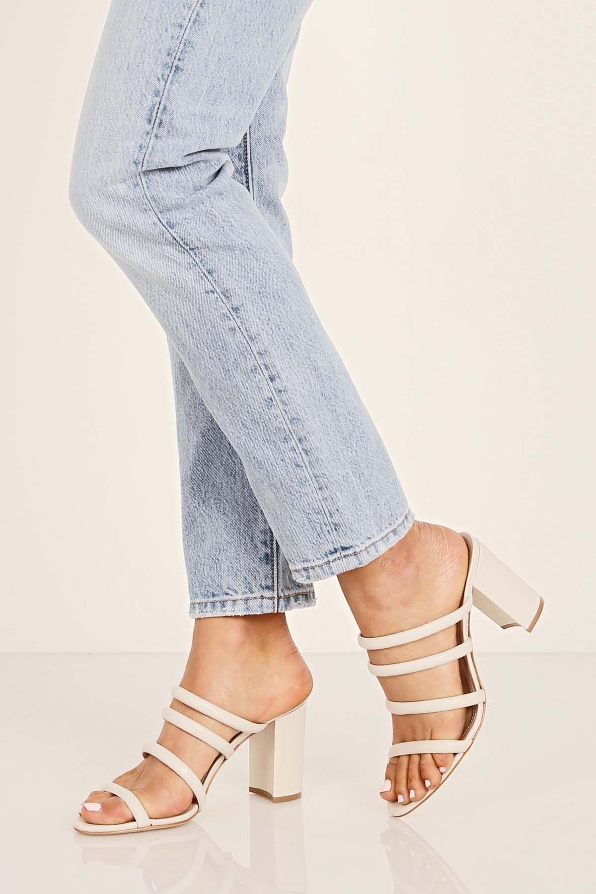 37bbdd93ba53 Shoes to dress us your denim  Schutz Shoes Felisa Heel. Off white strappy  slide with block heel