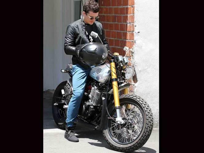 Orlando Bloom's bike was once a Yamaha SR500, but it's since been much modified by custom bike builders Deux Ex Machina.