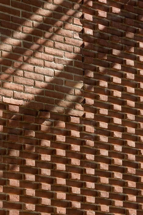 Detail shot of the prefabricated brick panels that form for Exterior brick design patterns