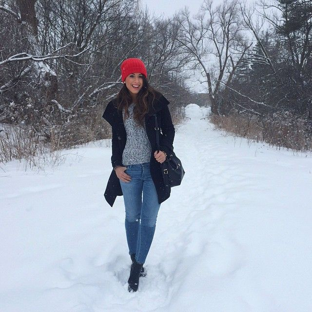 Mimi Ikonn | Red hat, black coat, grey sweater, skinny jeans, black ankle boots. Snow day outfit